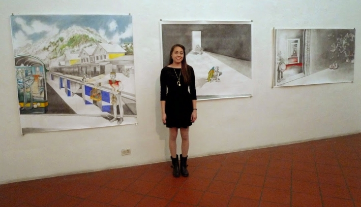 Allie Wong in front of her drawings