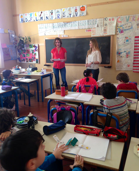 Anna Charney and Danielle Schaefer volunteering in local elementary school, Florence