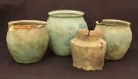 Three Roman buckets (first century CE) and one Etruscan bucket (third century BCE)