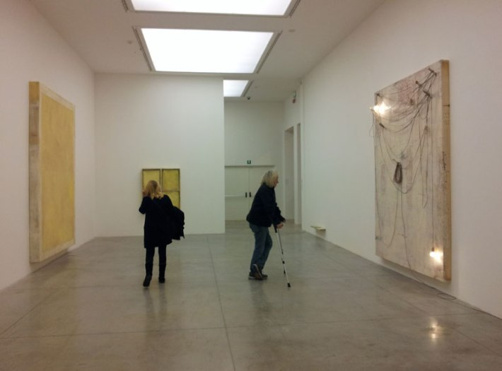 """Lawrence Carroll contemplating his installation """"Ghost House"""""""