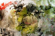 """Resa Blatman: """"Gaia,"""" part 1 (detail), 2014 (ongoing) Oil and glitter on laser-cut Mylar, PVC, and PETG; oil and latex paint on hand-cut Mylar; silk and plastic flora, 360w x 120h x 12d inches"""