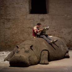 """Allora & Calzadilla """"Hope Hippo,"""" 2005, Mud, Whistle, Daily Newspaper, Reader. Installation View: """"Always a Little Further"""" 51st International Art Exhibition, la Biennale di Venezia, Photo: Giorgio Boata"""