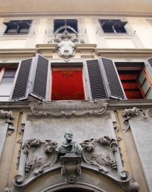 Façade of SACI's Palazzo dei Cartelloni with view of ceiling fresco and bust of Galileo
