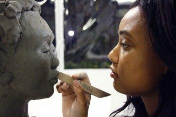 SACI student working in the sculpture studio