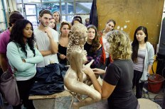 SACI sculpture students visiting a casting studio in Carrara