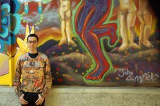 SACI student, John Gingrich in front of his mural project at Fili e Colori in Florence