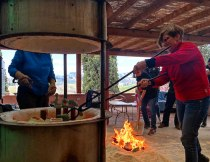 SACI ceramics instructor, Lisa Nocentini, doing raku firing at La Meridiana