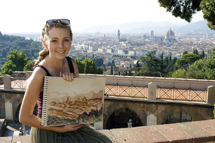 SACI drawing student with her sketch of the Florence skyline from San Miniato